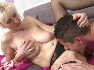 mature woman sucking a young dick