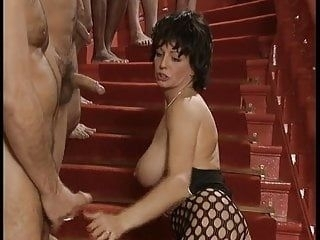 horny woman lines up cocks to suck